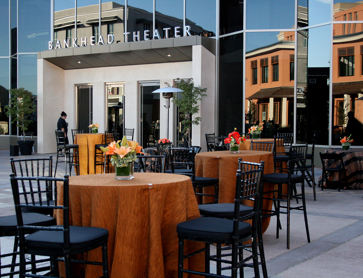 Tables set for an event in front of the Bankhead Theater
