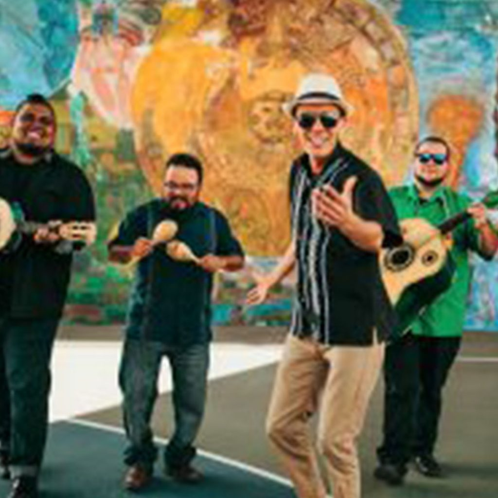 Jarabe Mexicano singing and playing their instruments.